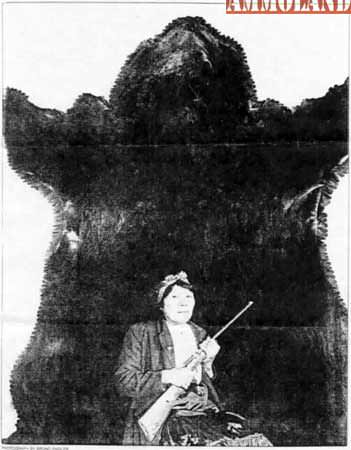 Bella Twin is shown with the hide from the world record grizzly bear
