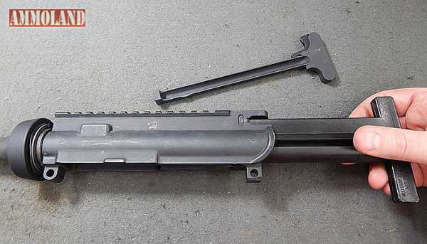 Figure 9: With the AR15 Rifle bolt carrier and charging handle removed and the receiver cleared of sights or optics, slide the action insert into the upper receiver.