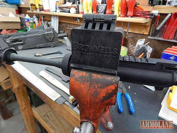 Figure 11: The AR-15 upper receiver clamped into the Brownells AR15 action block, and inserted into a vise.